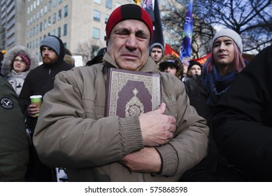 TORONTO-FEBRUARY 4:A Muslim man wiping his tears after hearing the names of the victims of the Quebec mosque attack during a rally in front of the US Consulate on February  4, 2017 in Toronto, Canada.