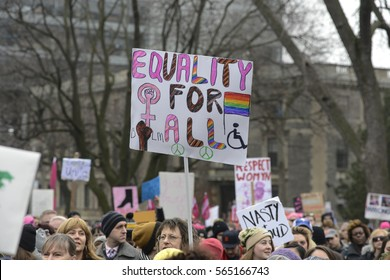 "TORONTO-JANUARY 21: Protestors with signs to denounce Donald Trumps' LGBTQ policies during the ""Women's March on Washington"" to protest against Trump presidency on January 21, 2017 in Toronto, Canada."