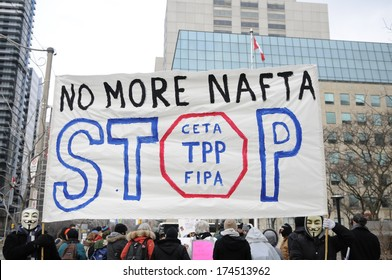 TORONTO-JANUARY 31:  People with No more Nafta sign during a rally to protest the proposed TPP  trade agreement and NAFTA  Agreement on January 31, 2014 in Toronto, Canada.