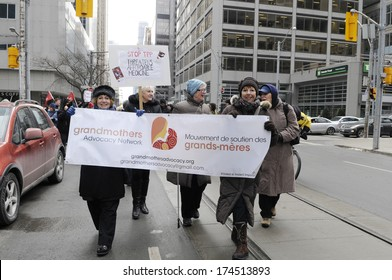 TORONTO-JANUARY 31: Protesters carrying banners and signs  during a rally to protest the proposed TPP  trade agreement and NAFTA  Agreement on January 31, 2014 in Toronto, Canada.