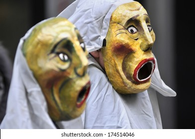 TORONTO-JANUARY 31:  Protesters wearing clay and paper masks chanting slogans during a rally to protest the proposed TPP  trade agreement and NAFTA  Agreement on January 31, 2014 in Toronto, Canada.