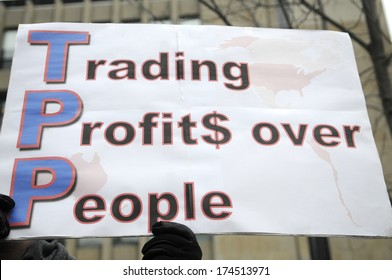 "TORONTO-JANUARY 31: A  sign saying ""trading profits over people""  during a rally  to protest the proposed TPP  trade agreement and NAFTA  Agreement on January 31, 2014 in Toronto, Canada."