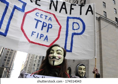 TORONTO-JANUARY 31:  Supporters wearing Guy Fawkes mask during a rally to protest the proposed TPP  trade agreement and NAFTA  Agreement on January 31, 2014 in Toronto, Canada.