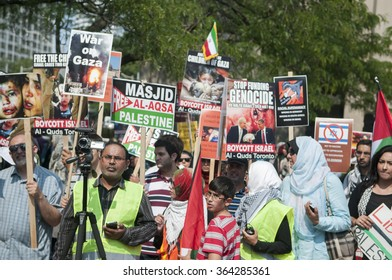 TORONTO-JULY 11: Muslims with signs and manners listening to the speakers during the Al-Quds day rally on July 11, 2015 in Toronto,Canada.
