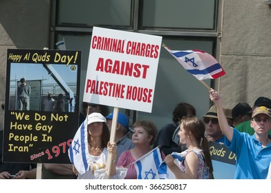 TORONTO-JULY 11: Pro-Israel supporters yelling and waiving signs  to oppose the the Al-Quds day rally on July 11, 2015 in Toronto,Canada.