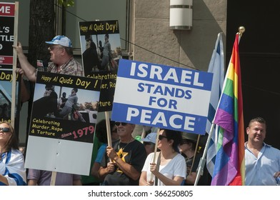TORONTO-JULY 11: Supporters of Israel with signs saying Israel stands for peace during a rally to oppose the the Al-Quds day on July 11, 2015 in Toronto,Canada.
