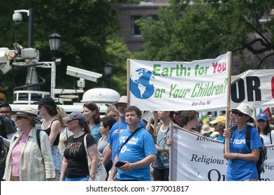 "TORONTO-JULY 5 :Protesters with signs to convince people to take care of the ""Planet Earth"" now for the future generations during the Jobs,Justice and Climate rally on July  5, 2015 in Toronto,Canada."