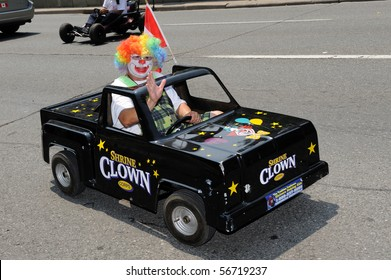 TORONTO-JULY 6:  Clown in funny little black car takes part in 136th annual Shriners convention  on July 06, 2010 in Toronto