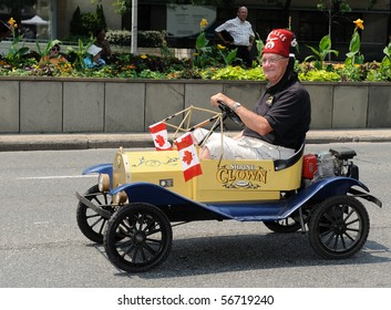 TORONTO-JULY 6: Shriner on funny little yelow car takes part in 136th annual Shriners convention  on July 06, 2010 in Toronto