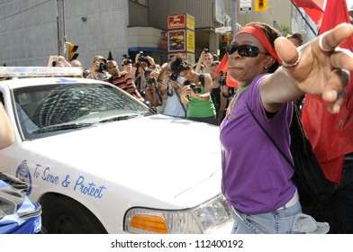 TORONTO-JUNE 25:  An angry protesters stopping a police vehicle  during the G20 Protest on June 25, 2010 in Toronto, Canada.