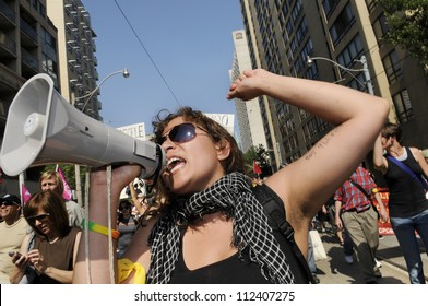 TORONTO-JUNE 25: An angry woman  protester chanting slogans with a microphone during the G20 Protest on June 25, 2010 in Toronto, Canada.