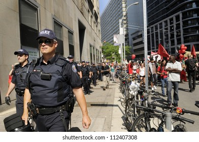 TORONTO-JUNE 25:  Toronto police marching and protecting the sidewalks during the G20 Protest on June 25, 2010 in Toronto, Canada.