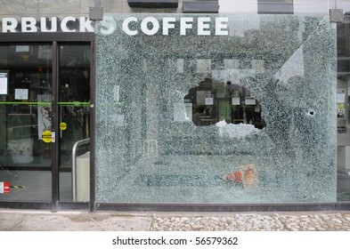 TORONTO-JUNE 26: StarBucks coffee shop window was smashed during G20 protests on June, 26 2010 in Toronto , Canada.