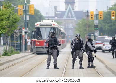 TORONTO-JUNE 27:  Elite  police personnel with gas masks protecting the street car tracks  during the G20 Protest on June 27, 2010 in Toronto, Canada.