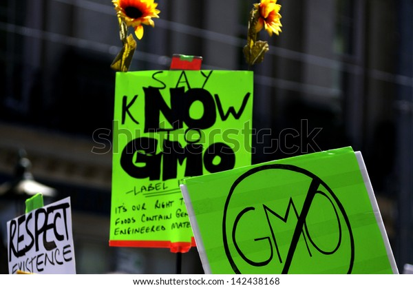 TORONTO-MAY 25: A banner asking to put label on foods to clarify if it has Genetically modified material during a rally  against GMO giant Monsanto on May 25, 2013 in Toronto, Canada.
