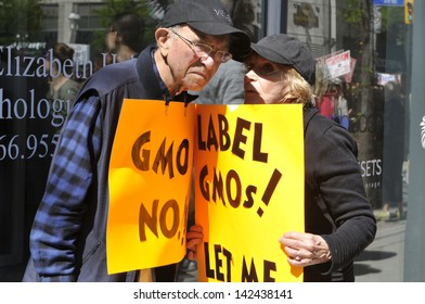 TORONTO-MAY 25: An old couple talking with each other during a rally  against GMO giant Monsanto on May 25, 2013 in Toronto, Canada.