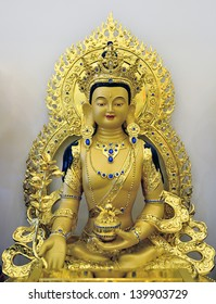 TORONTO-MAY 26: Gold plated Medicine Buddha statue in the newly opened  Jing Yin Buddhist Temple in Toronto, Canada, on May 26, 2013.