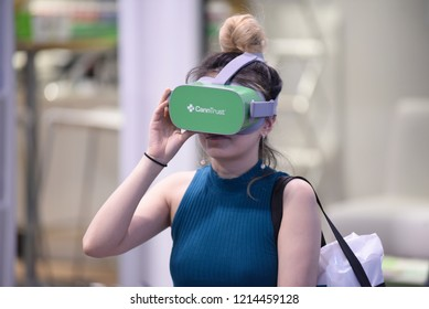 TORONTO-MAY 27: A customer wearing a virtual reality headset while getting a demostrationduring the cannabis expo on May 27 2018 in Toronto,Canada