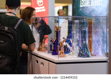 TORONTO-MAY 27: People looking at bongs on display during the cannabis expo on May 27 2018 in Toronto,Canada
