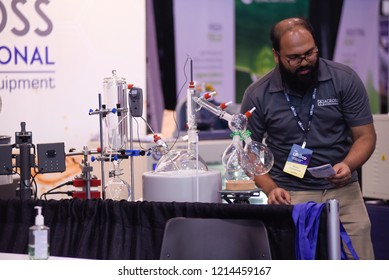 TORONTO-MAY 27: A vendor inspecting his equipment during the cannabis expo on May 27 2018 in Toronto,Canada