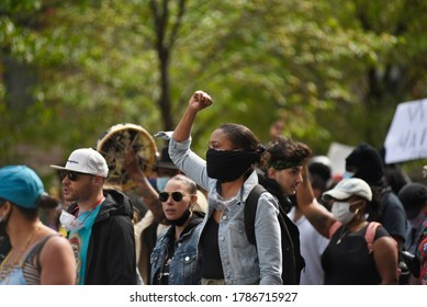 TORONTO-MAY 30:A protester wearing mask and chanting slogans during a rally to protest the death of a Black woman with mental illness, who died in police presence on May 30,2020 in Toronto,Canada