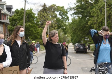TORONTO-MAY 30:By standers showing BLM fist during a rally to protest the death of a Black woman with mental illness, who fell from her balcony in police presence on May 30,2020 in Toronto,Canada