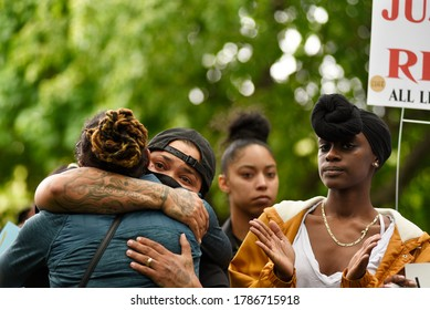 TORONTO-MAY 30:Family members hugging each other during a rally to protest the death of a Black woman with mental illness, who fell from her balcony in police presence on May 30,2020 in Toronto,Canada