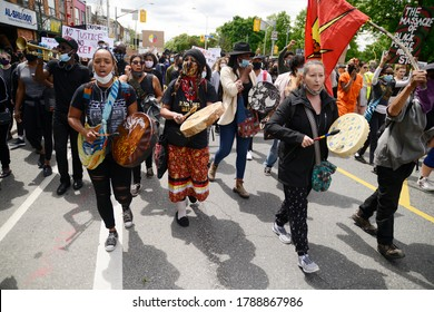 TORONTO-MAY 30:Indigenous musicians singing during a rally to protest the death of a Black woman with mental illness, who fell from her balcony in police presence on May 30,2020 in Toronto,Canada