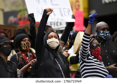 TORONTO-MAY 30:People chanting slogans and showing  BLM fist during a rally to protest the death of a Black woman with mental illness, died in police presence on May 30,2020 in Toronto,Canada