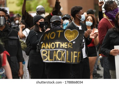 """TORONTO-MAY 30:People with signs saying """"not another black life"""" during a rally to protest the death of a Black woman with mental illness, died in police presence on May 30,2020 in Toronto,Canada"""