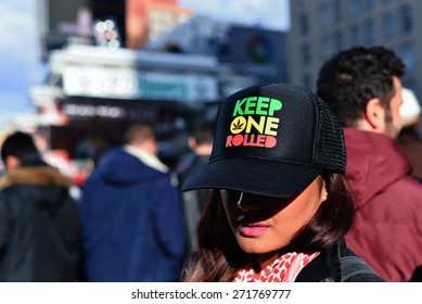 TORONTO/ONTARIO CANADA - 2015 APRIL 20:A girl showing hat saying keep one rolled on, in yonge dundas square in Toronto.