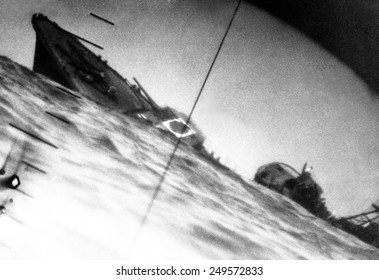 Torpedoed Japanese destroyer seen through periscope of USS Wahoo or USS Nautilus during World War 2. June 1942.