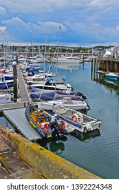 Torquay, Devon / England - 5/3/2019: Boats of all shapes & sizes moored in the marina at Torquay. Expensive motor yachts in background.