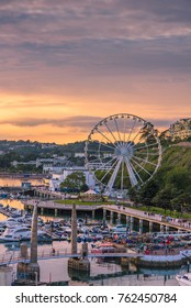 Torquay, Devon, England. August 2017 - Panoramic view of the harbor of the popular seaside resort town during a colorful sunset.