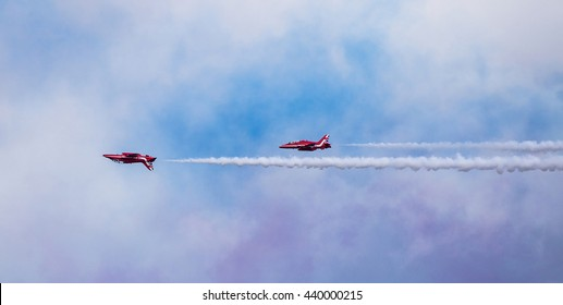 Torquay, Devon, UK, 12 June 2016 Showing the various formations of the RAF Red Arrows air display at the Torquay airshow, shot from public land during an overcast day