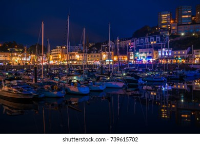 TORQUAY, DEVON UK - OCTOBER 14, 2017: Night view of the harbor in Torquay. Torquay, a seaside town in Devon, known as English Riviera, is a fashionable holiday resort and a popular tourist destination