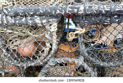 Torquay, United Kingdom, February 1, 2019.  Close up of a pile of lobster pots quayside on Torquay harbour wall.  Winters day.  Torquay, United Kingdom, February 1, 2019