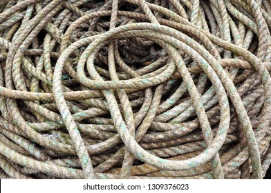 Torquay, United Kingdom, February 1, 2019.  Torquay harbour.  Close up of a pile of old rope on the quayside.  Winters morning.  Torquay, United Kingdom, February 1, 2019.