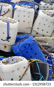 Torquay, United Kingdom, February 1, 2019.  Overcast winters day. White and blue plastic lobster pots on the harbour quay side.  Torquay, United Kingdom, February 1, 2019