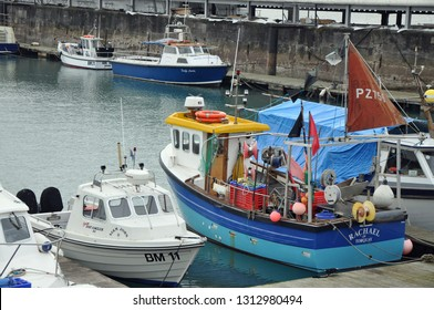 Torquay, United Kingdom, February 1, 2019.  Colourful fishing boat and other small boats in Torquay Marina on a winters day in the off season.  Torquay, United Kingdom, February 1, 2019.