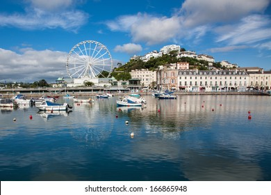 TORQUAY,ENGLAND-AUGUST 20: Boats sit peacefully on the water in Torquay on August 20, 2012. Torquay was the childhood home of Agatha Christie, and a festival is held in her honor yearly.