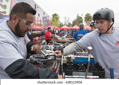 Torrance, USA - May 5 2017: Students competing to build the first engine at the Hot Rodders of Tomorrow Engine Challenge  during 12th Annual Edelbrock Car Show.