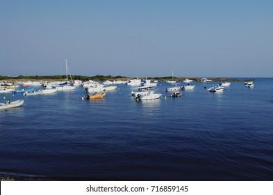 Torre Colimena Bay - Boats moored. Manduria, Apulia, Italy.
