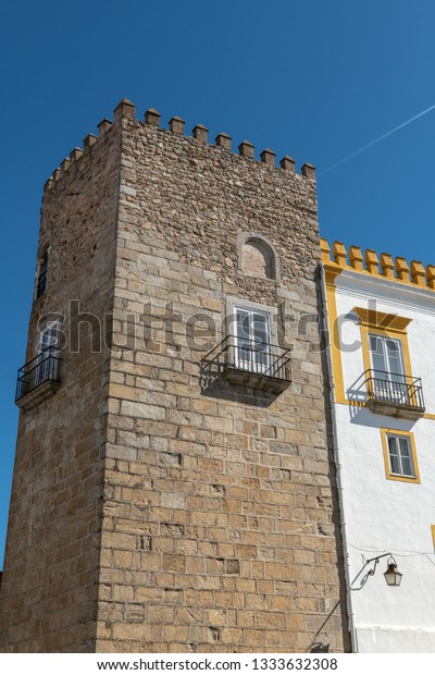 Torre das Cinco Quinas on the The Palace of the Dukes of Cadaval is located in Évora historic centre, in Portugal, facing the Roman Temple of Évora.