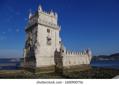 Torre de Belem (Lisbon Landmark) in a low tide and blue sky