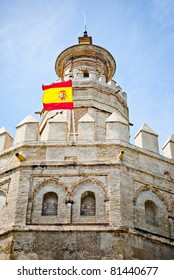 Torre De Oro in Sevilla with flag of Spain