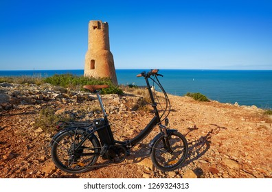 Torre del Gerro tower in Denia with foldable ebike e-bike