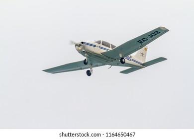 TORRE DEL MAR, MALAGA, SPAIN-JUL 31: Aircraft Piper PA-28-161 Warrior III taking part in a exhibition on the 1st airshow of Torre del Mar on July 31, 2017, in Torre del Mar, Malaga, Spain