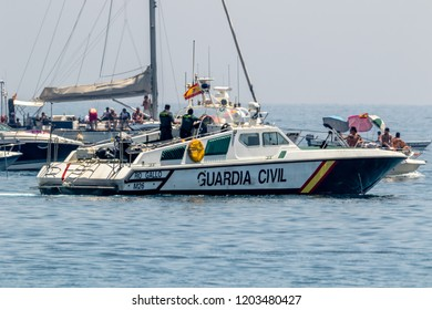 TORRE DEL MAR, MALAGA, SPAIN-JUL 30: Guardia Civil coast guard patrol taking part in a exhibition on the 2nd airshow of Torre del Mar on July 30, 2017, in Torre del Mar, Malaga, Spain