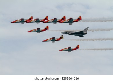 TORRE DEL MAR, MALAGA, SPAIN-JUL 31: Aircraft of the Patrulla Aguila and Eurofighter EF-2000 taking part in a exhibition on the 1st airshow of Torre del Mar on July 31, 2016, in Torre del M